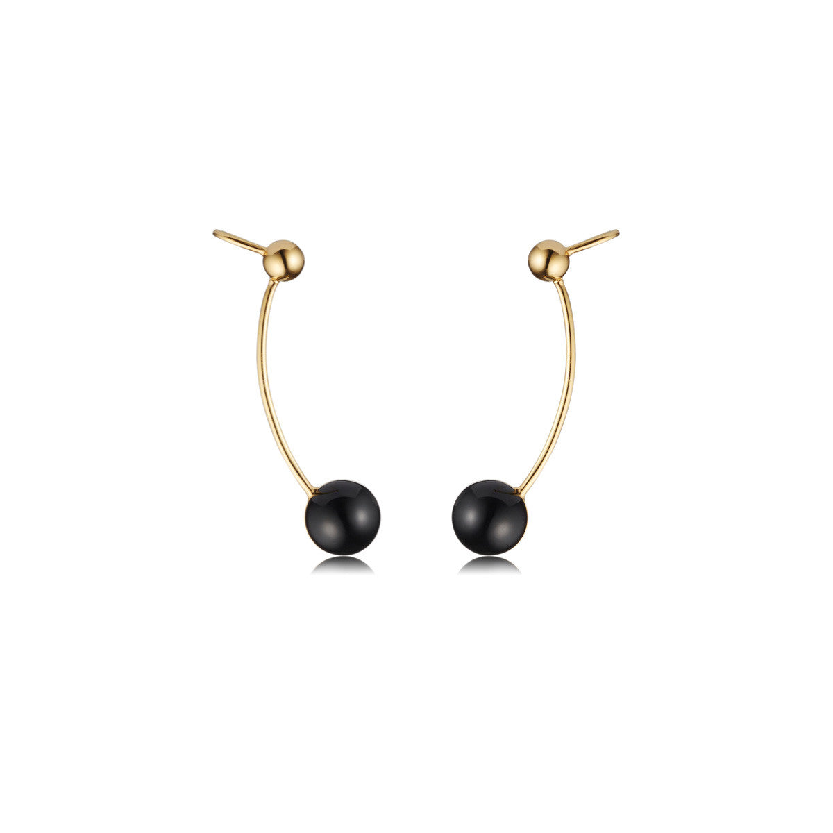Solid brass, 18K gold plated Stella Crinita ear cuffs are set in hand cut natural black onyx - front