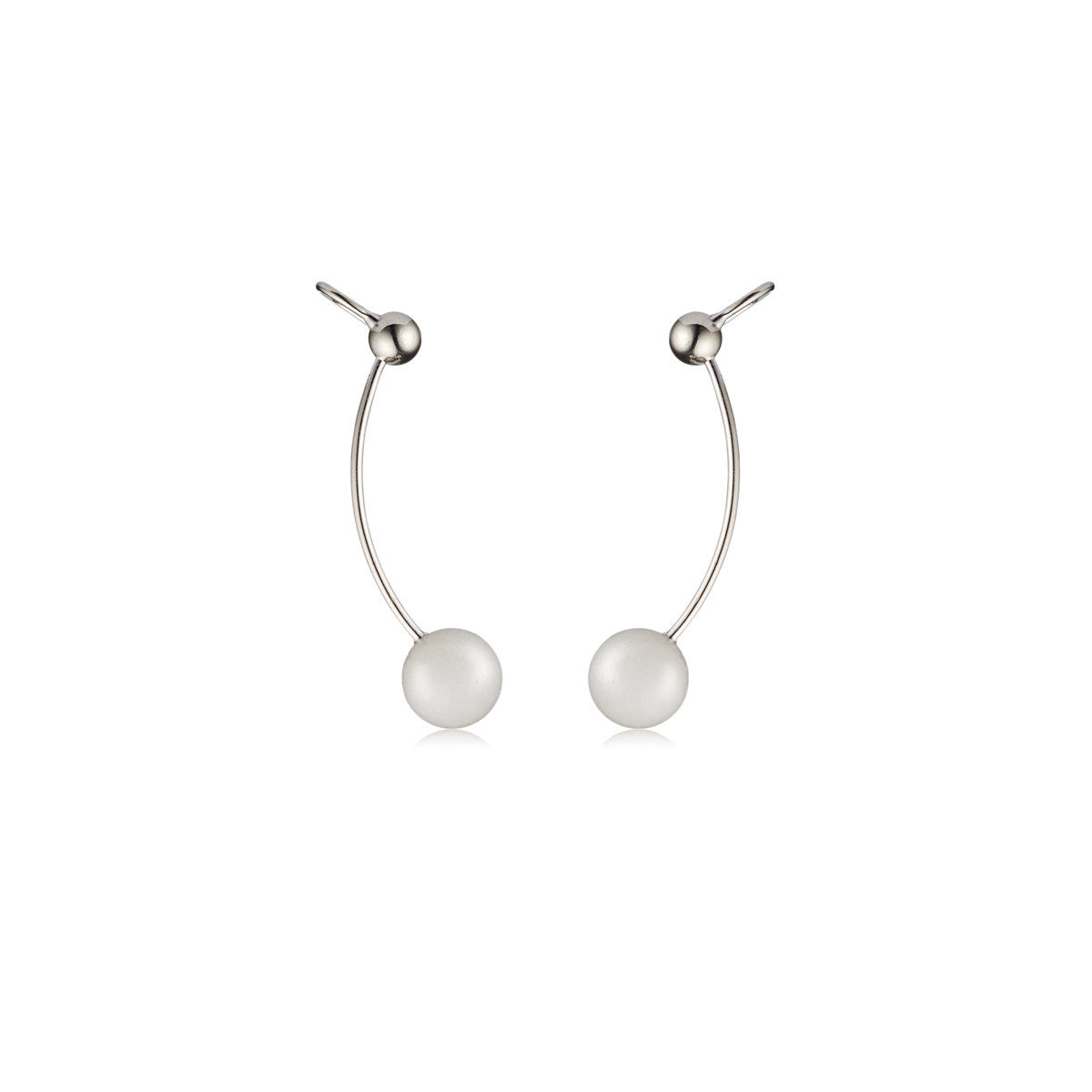Solid brass, rhodium plated Stella Crinita ear cuffs are set in hand cut natural white agate – front