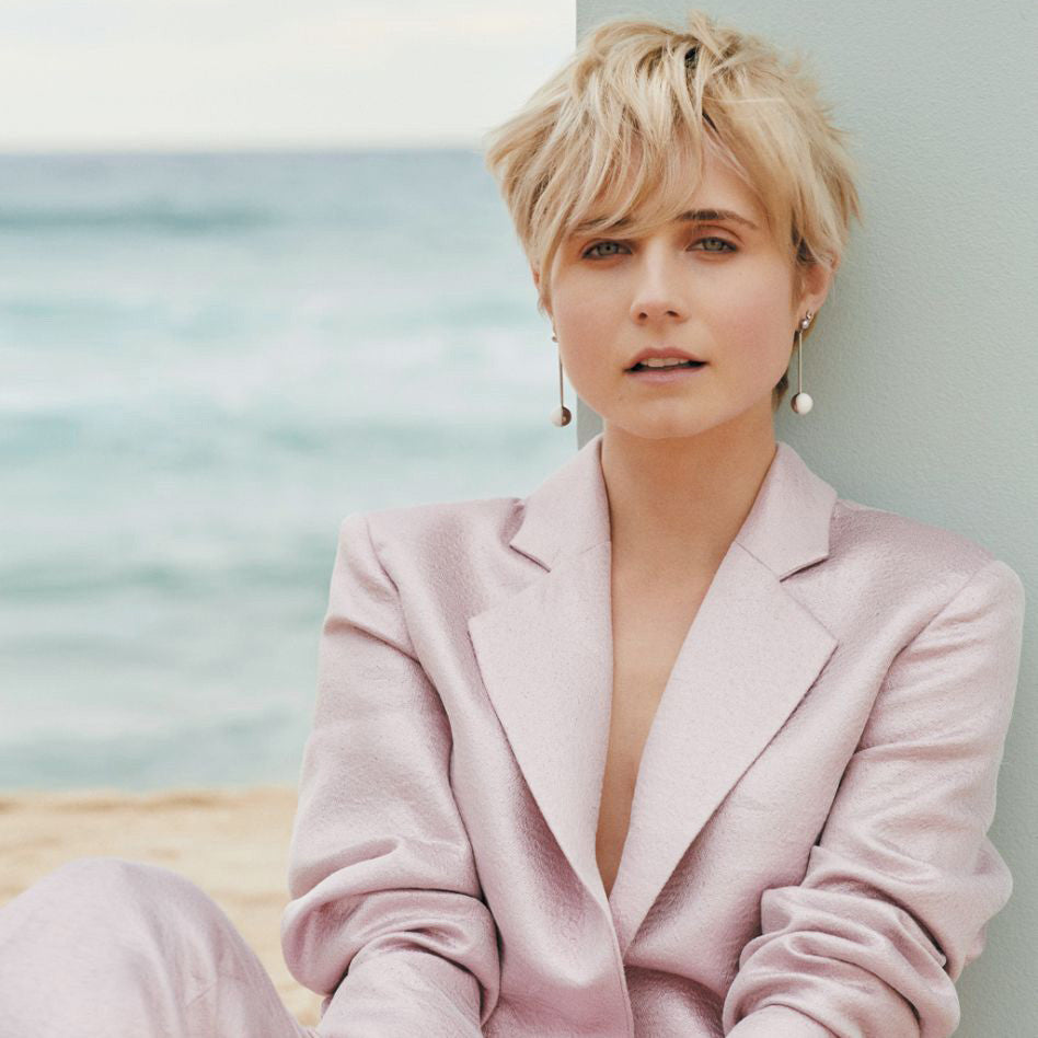 Actress Tessa James in Sunday Life magazine wears Sarina Suriano Luna earrings in white agate and genuine rhodium plating from the Sphera collection