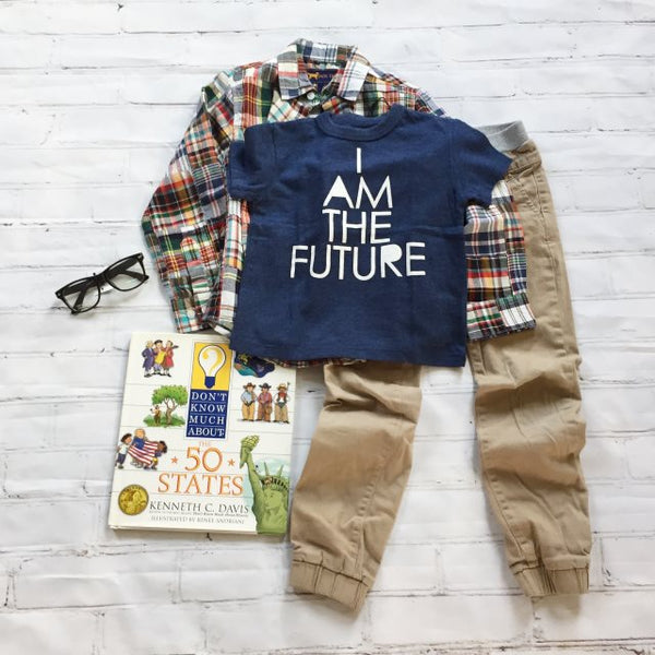I am the Future t-shirt, plaid shirt, khaki pants, and kids nerd glasses