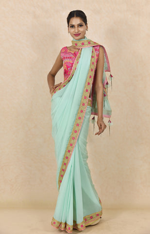 Aqua Embroidered Saree With Pink Embroidered Blouse
