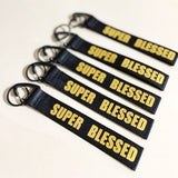 SUPER BLESSED Black Gold Wrist strap keychain