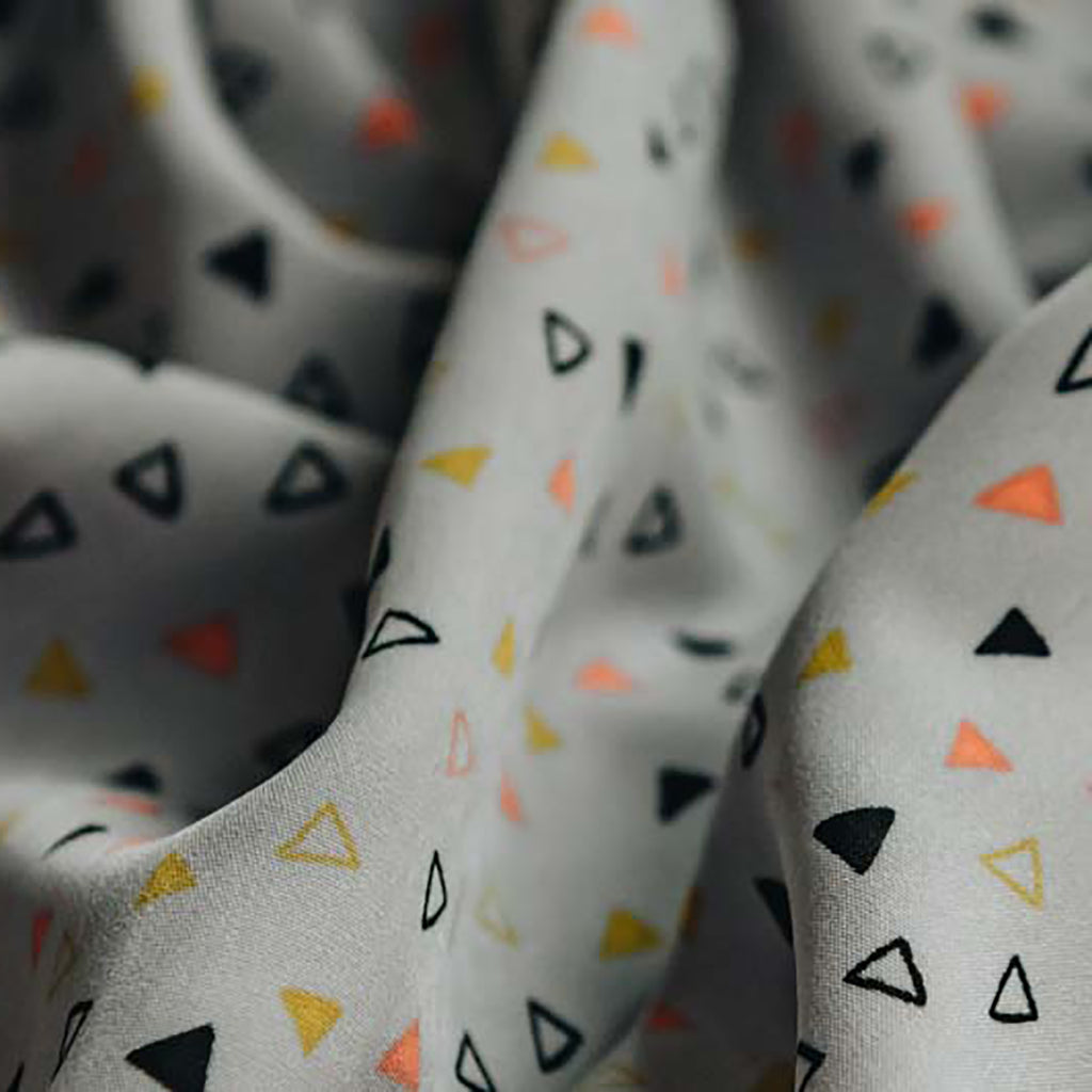 Geometric Triangles Printed Soft Touch Peachskin Woven Dress Fabric - Grey