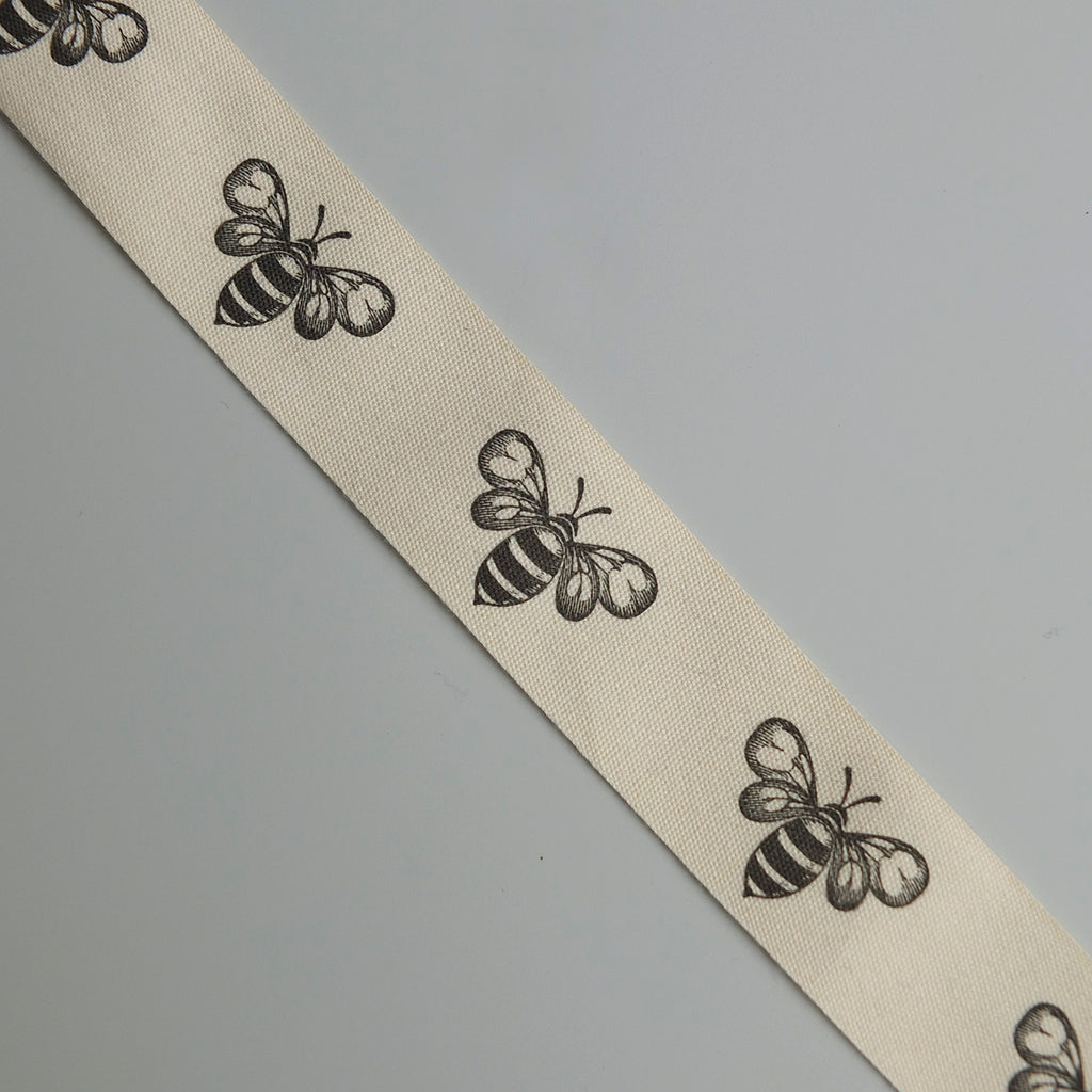 2 metres of Cream Cotton Ribbon with Bee Print - 25mm wide