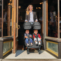 Baby Jogger City Tour 2 - Double (Pitch Black) - lifestyle image. showing the stroller fitting through a doorway