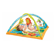 Tiny Love Gymini Playmat (Sunny Day) - showing a baby playing with the hanging toys