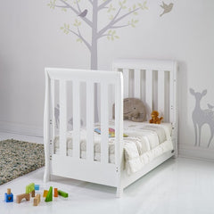 Obaby Stamford Mini Sleigh Cot Bed with Drawer (White) - lifestyle image, shown as junior bed