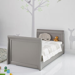 Obaby Stamford Sleigh Cot Bed (Taupe Grey) - lifestyle image, shown as the junior bed