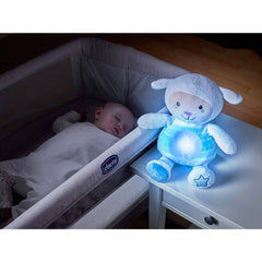 Chicco First Dreams Lullaby Sheep Night Light (Blue) - lifestyle image, showing the sheep with its light activated