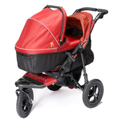 Out n About Nipper 360 v4 Pushchair & Carrycot (Carnival Red) - quarter view, showing the carrycot fitted onto the pushchair