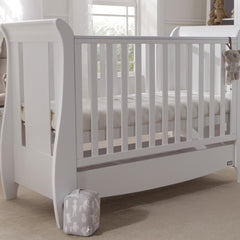 Tutti Bambini Katie Space Saver Sleigh Cot Bed (White) - lifestyle image, showing the cot with the mattress base raised