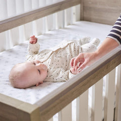 Tutti Bambini Modena Cot Bed (Oak with White) - lifestyle image, shown with mattress base at its highest level