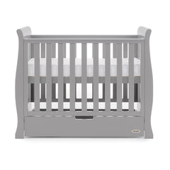 Obaby Stamford Space Saver Cot (Warm Grey) - side view, shown with mattress base at highest level (mattress not included, available separately)
