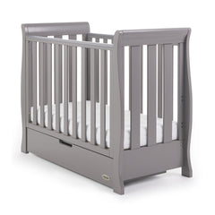 Obaby Stamford Space Saver Cot With SPRUNG Mattress (Taupe Grey) - quarter view, shown with mattress base at lowest level