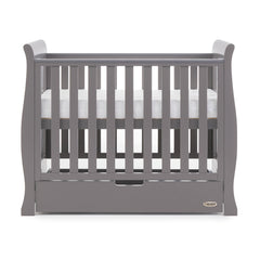 Obaby Stamford Space Saver Cot With SPRUNG Mattress (Taupe Grey) - side view, shown with mattress base at highest level