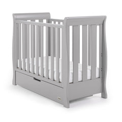 Obaby Stamford Space Saver Cot With Sprung Mattress (Warm Grey) - quarter view, shown with mattress base at lowest level