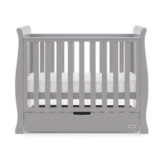 Obaby Stamford Space Saver Cot With Sprung Mattress (Warm Grey) - side view, shown with mattress base at middle level