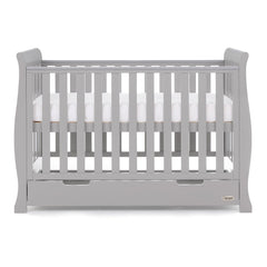 Obaby Stamford Mini Sleigh Cot Bed with Drawer (Warm Grey) - side view, shown here as the cot with the mattress base at its highest level