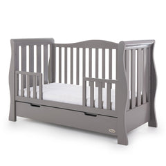 Obaby Stamford Luxe Sleigh Cot Bed with Drawer (Taupe Grey) - quarter view, shown here as the junior bed with the protective side rails