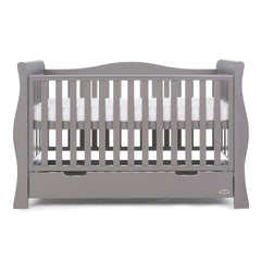 Obaby Stamford Luxe Sleigh Cot Bed with Drawer (Taupe Grey) - front view, shown with the mattress base at its highest level