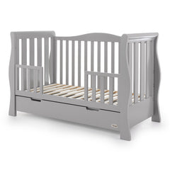 Obaby Stamford Luxe Cot Bed (Warm Grey) - quarter view, shown with the mini side rails