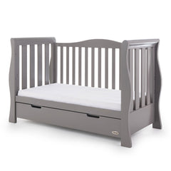 Obaby Stamford Luxe Sleigh Cot Bed with Drawer (Taupe Grey) - quarter view, shown here as the sofa/day bed