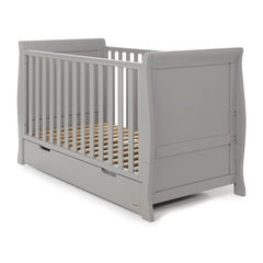 Obaby Stamford Sleigh Cot Bed with Drawer (Warm Grey) - quarter view, shown here as the cot