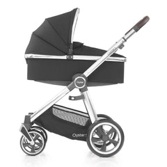 Babystyle Oyster 3 Carrycot (Caviar) - side view, shown here with the chassis as the pram