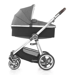 Babystyle Oyster 3 Carrycot (Mercury) - side view, shown here with the chassis as the pram