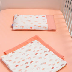ClevaMama Replacement Baby Pillow Case Cover (Coral) - lifestyle image, shown being used in a cot (other bedding not included)