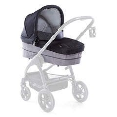 Hauck Saturn Carrycot (Caviar/Stone) - quarter view, showing the carrycot fixed onto the Saturn R`s chassis (stroller not included, available separately)