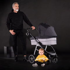 Hauck Saturn R Stroller & Carrycot Bundle (Caviar/Stone) - lifestyle image of the pram