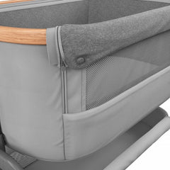 Maxi-Cosi Iora Co-Sleeping Crib (Essential Grey) - close view, showing the mesh front panel