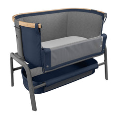 Maxi-Cosi Iora Co-Sleeping Crib (Essential Blue) - quarter view, shown here with side mesh panel lowered