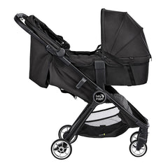 Baby Jogger City Tour 2 Carrycot - Single (Pitch Black) - side view, showing the carrycot attached to a stroller (stroller not included)