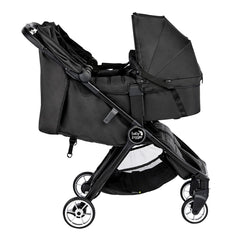 Baby Jogger City Tour 2 Carrycot - Double (Pitch Black) - side view, showing the double stroller with two carrycots attached (stroller not included, available separately)