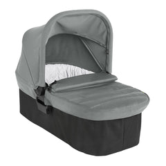 Baby Jogger City Mini 2 Carrycot (Slate) - quarter view, shown with the apron flap lowered