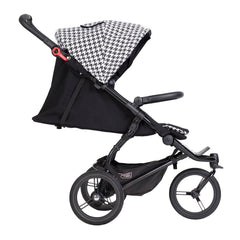 Mountain Buggy Swift - Luxury Collection (Pepita) - side view, shown here with seat in lie-back position for newborns