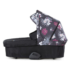 Hauck Saturn Carrycot (Wild Blooms) - side view, shown here resting on its protective feet