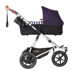 Mountain Buggy Urban Jungle - Luxury Collection Bundle (Nautical) - side view, showing the carrycot and chassis in use as the pram