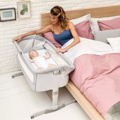 Chicco Next2Me Crib - Dream (Luna) - lifestyle image, shown beside parents` bed