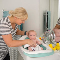 ClevaMama ClevaBath - The Bath Sink (Aqua) - lifestyle image, shown here with baby in a bathroom sink