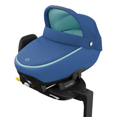 Maxi-Cosi Jade i-Size Car Cot (Essential Blue) - quarter view, showing the Jade fixed onto an ISOFIX base (base not included, available separately)