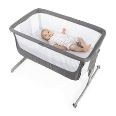 Chicco Next2Me Crib - Air (Dark Grey) - lifestyle image, shown here with an infant