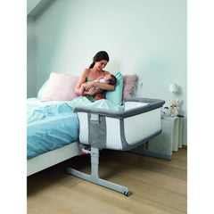 Chicco Next2Me Crib - Air (Dark Grey) - lifestyle image, shown here fixed to a parent`s bed