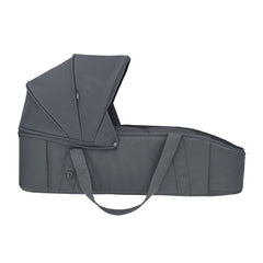 Maxi-Cosi Laika Soft Carrycot (Essential Graphite) - side view, showing one of the carrying handles