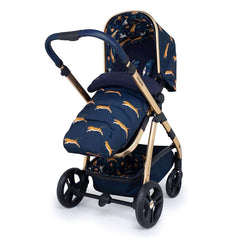 Cosatto Wow Pram & Accessories Bundle - Paloma Faith (On The Prowl) - quarter view, showing the pushchair in parent-facing mode with the footmuff