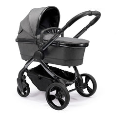 iCandy Peach Phantom Pushchair & Carrycot (Dark Grey Twill) - quarter view, showing the carrycot and chassis together as the pram