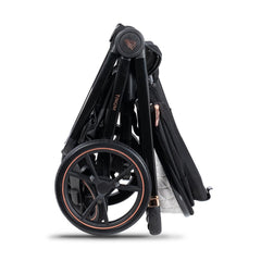 Venicci Tinum 3-in-1 Travel System (Stylish Black SE) - showing a side view of the folded pushchair