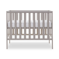 Obaby Bantam Space Saver Cot (Warm Grey) - side view, shown with mattress base at its highest level (mattress not included, available separately)